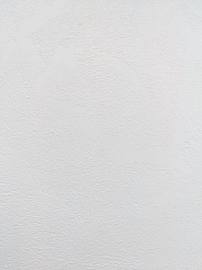 Wallpaper with a plaster textured effect